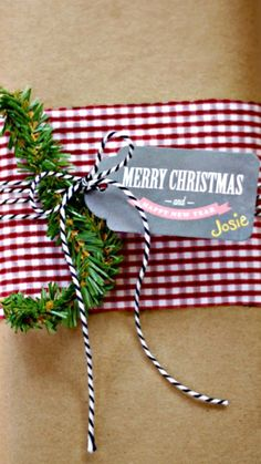 Brown Paper – then layer a fabric scrap over the middle and use baker's twine to tie on a tag – easy breezy