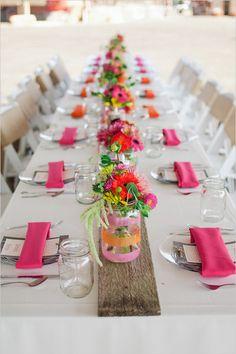 pink and orange wedding decor  I love the decorated mason jar vases. DIY?