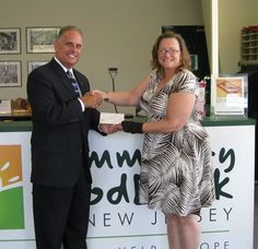 Pictured are Community FoodBank of New Jersey Southern Branch Executive Director Evelyn Benton and Ocean City Masonic Club President Steven Friedrich.