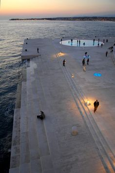 """""""Morske Orgulje"""" and or """"The Sea Organ"""" Nikola Basic. Located on the shores of Zadar, Croatia, is the world's first pipe organ which plays music by way of sea waves and 35 musically tuned polyethylene tubes located underneath a set of large marble steps---2005"""