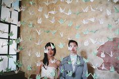 Hundreds of paper cranes make a fantastic wedding back drop!   Ruffled