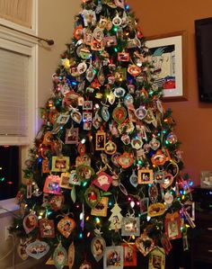 Photo memory Christmas tree. Every year, each member of the family takes a picture and puts it in a photo frame with the date. Over the years, it's fun to look back at the christmas's past