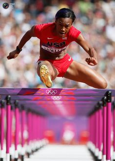 Kellie Wells of the U.S. clears a hurdle during her women's 100m hurdles round 1 heat during the London 2012 Olympic Games