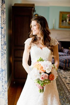 Rose and ranunculus bridal bouquet  | Harrison Studio | Brides.com
