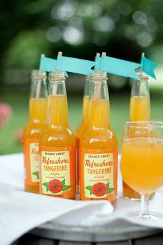 Fun little paper flags add even more appeal to these lovely bottles of Trader Joe's Carbonated Tangerine Juice. #tangerine #orange #food #drinks #bottles #wedding #party #flags #juice