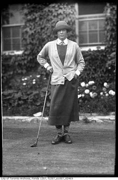 A lady named Cathy Christie enjoying a day of golfing, Toronto, c. 1922. Fashion with argyle socks, long skirt, sweater and vest, shorter hair with snood hat.  You could golf in this.
