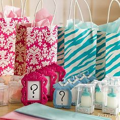 """Patterned favor bags are adorable reminders that everyone found out """"boy or girl"""" together at your gender reveal baby shower!"""