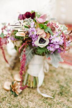 bohemian bouquet, photo by Revel and Bloom http://ruffledblog.com/lovestruck-wedding-inspiration #flowers #weddingbouquet