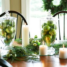 Combine green fruit and green ornaments for a cohesive tabletop display. More elegant holiday arrangements: http://www.bhg.com/christmas/indoor-decorating/holiday-table-arrangements/?socsrc=bhgpin103012greenfruitdisplay#page=13