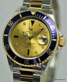 Rolex Submariner Date in 18K & Stainless Steel with factory champagne Serti dial with blue sapphires & diamond markers on an Oyster Bracelet. Circa 1997 /12 $7,650.00