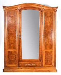 Eugéne Gaillard (1862-1933) - Armoire. Carved & Inlaid Wood and Mirrored Glass with Bronze Hardware. Circa 1900.
