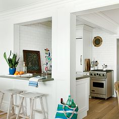 This kitchen features apartment-size appliances instead of full-size ones to make the space feel larger. coastalliving.com