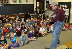 "Mick Souter performs his acclaimed show ""The Roads and Rails of Woody Guthrie"" at the Mountaineer Montessori School in Charleston Monday morning."