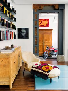 A YOUNG, FRESH, AND FUNKY HOME IN SPAIN Designer María Lladó mixes modern and rustic furniture with free-spirited art and accessories for a space that feels totally youthful.