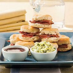 Country Ham and Biscuits | For a Derby Day classic, bake frozen tea biscuits and fill with thin slices of country ham. Have guests dress biscuits with flavored butter and mustard blends. | SouthernLiving.com