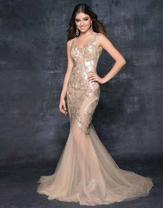 Blush Prom 9526 - Red carpet drama in a formal prom dress! This stunning gown cascades your silhouette in tonal petals that float across the matching champagne chiffon. #prom