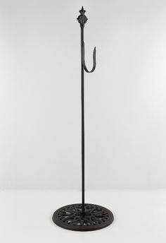 """24"""" Black Cast Iron Stand with hook. I'm thinking this will look cute by the front door holding a hanging plaque with our name.  Change the plaque for each season."""