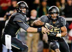 Baylor quarterback Bryce Petty fakes a handoff to Lache Seastrunk (25). (Tony Gutierrez/AP)
