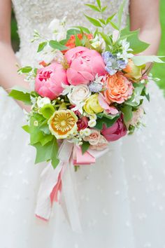 gorgeous bouquet of peonies, roses, garden roses, and hellebores