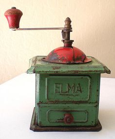 "Add antique pieces like this ""Elma"" Coffee Mill / Grinder to the kitchen for a touch of personality and flair. This item was made in the 1920's by the ""Elma Company"" of Spain."