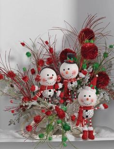 Whimsical Christmas centerpiece using a trio of skinny legged, big head Snowmen from the RAZ 2013 Holiday on Ice Collection. See more ideas and images on the Blog post http://www.trendytree.com/blog/raz-2013-holiday-on-ice-decorating-ideas-and-inspiration/
