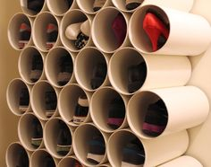 First, cut large-diameter PVC pipe into pieces of equal length, then fasten them together with heavy-duty velcro. The result? A flexible storage rack for shoes or miscellaneous other personal items. Make your PVC DIY honeycomb three or four rows high, or run it all the way from floor level to ceiling height.