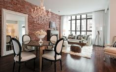 Chandeliers and brick walls make for great design tension