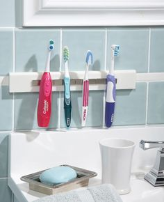 Use magnets and a Corian mounting strip - Magnetic toothbrush holder