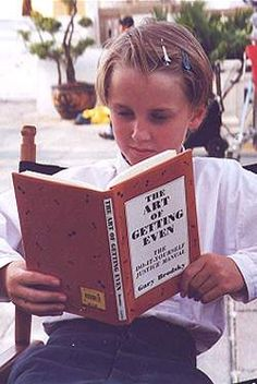 "Young Draco doing some research?! Tom Felton reading ""The Art of getting Even"""