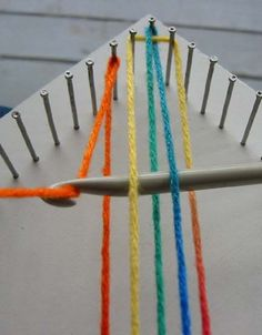 this is a loom that you make with nails and wood to make afghan squares...like the old pot holder looms