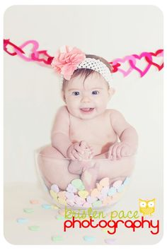 Baby in glass bowl with candy hearts