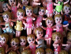 Kewpie dolls on a stick