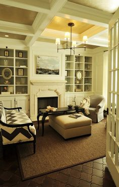 gold ceiling + ceiling details + white shelves and fireplace