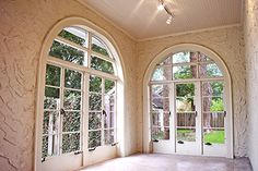 4-Season Porch with high ceiling and large arched windows.