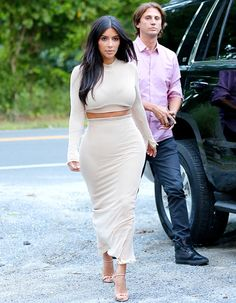 Knockout in nude! Kim Kardashian continued to wow in New York, as she showed some skin in a sexy crop top look in the Hamptons. Love her nude Prada heels! See all the pics!