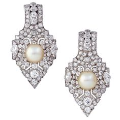 CARTIER Pair of Natural Pearl Diamond Brooches
