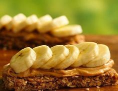 This smart snack couldn't be any easier.  Spread a granola bar with peanut butter and add banana slices -- how cool is that