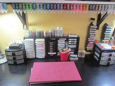 My Stamping Station - Scrapbook.com- use velcro underneath a shelf for stickles storage.