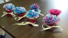 These were done by my Girl Scout troop.  We combined the kcup flower pots with the tissue paper flowers that I have pinned in my crafts I want to try.  They came out super cute!