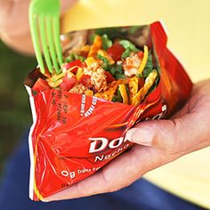 Walking Tacos (Perfect Tailgating Recipe): Snack Size Bag Doritos, Seasoned Taco Meat, Shredded Cheese, Shredded Lettuce, Diced Tomatoes, Diced Onions, Sour Cream, Plastic Fork - Crush Chips; Cut Open Chip Bag To Bowl Shape; Add Meat, Cheese, Lettuce, Tomatoes, Onions, Sour Cream; Grab Fork & You're Ready For The Big Game! football games snacks, sour cream, tailgating recipes, bag, walking tacos, tailgate food, doritos recipes, football foods, walk taco