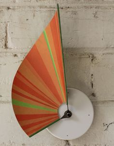 Insane smart and cool clock. The two arms are attached to a sheet of paper that make the clock change its shape during 12h.