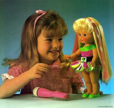 Li'l Miss Magic Hair. I don't remember if I had one or it was a friend/babysitter. There may have also been a Lil Miss Makeup. I wanted to know how they made the colors disappear!