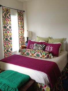 Jewel tone bedroom decorations using Waverly Santa Maria fabric in Desert Flower. Cream spread is Vera Wang from Kohls and Purple shams and quilt are from TJ Maxx