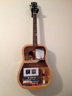 Broken guitar transformed into a shelf