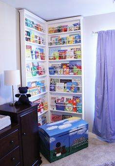 What a fun library corner of the nursery! This corner bookcase was built by mom and grandpa. #nursery #librarywall