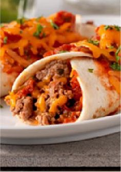 Cheesy Beef Enchiladas -- Skip the fuss of dining out and serve a hearty, cheesy ground beef–filled enchilada bake that's ready in no time.