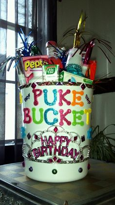 Great 21st bday gift.  Fill a bathroom trash can with all the essentials for a hangover such as pepto, tylenol, clips to hold hair back, gum, mouthwash, washclothes and decorate