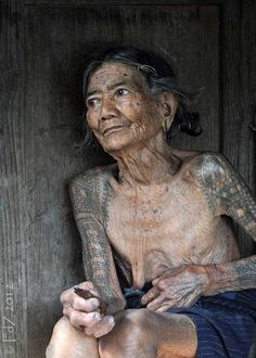 """the last old tattooed women of Buscalan, high up in the rugged rice terraces of Kalinga . The batok (tattoos) of these women were not only designed to enhance their beauty and confer status, they also symbolize their female strength and stamina."" - from the post: Kalinga - Part IV - Old Tattooed Women"