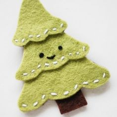 Bring a smile to someone's face with this happy Christmas tree pin!