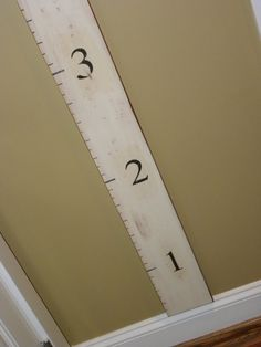 So in love with this idea.  Must do it asap, and transfer all the marks we have on our walls from measuring, onto this board.